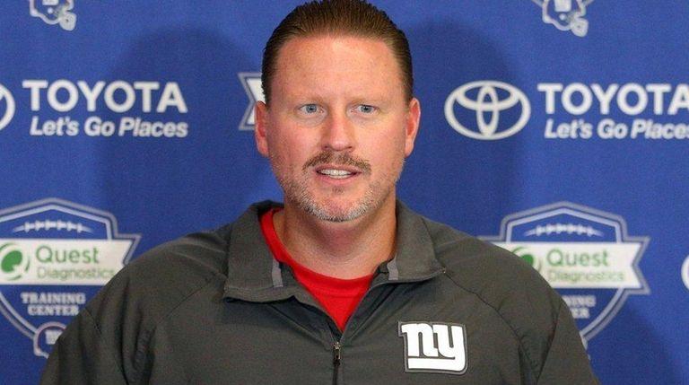 Giants head coach Ben McAdoo talks to the