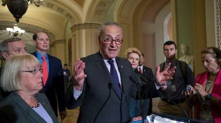 Senate Minority Leader Chuck Schumer (D-N.Y.), with, from