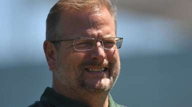 Jets general manager Mike Maccagnan watches the second day of