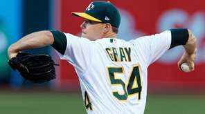 Sonny Gray of the Oakland Athletics pitches against