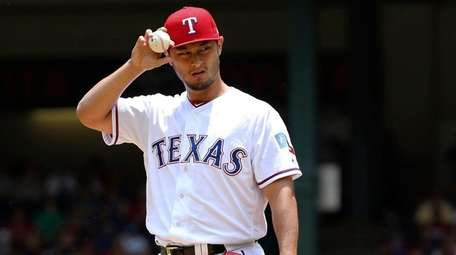 Texas Rangers starting pitcher Yu Darvish adjusts his
