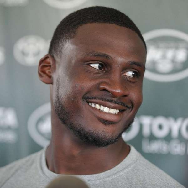 Morris Claiborne #21 speaks to the media after