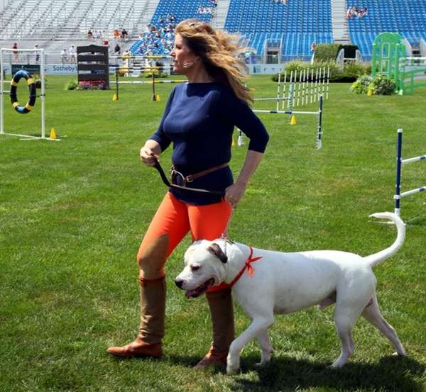 Jill Rappaport stands and her dog Peevy at