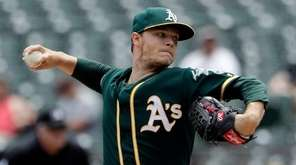 Oakland Athletics starting pitcher Sonny Gray throws to
