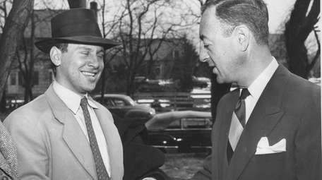 Mortimer Weiss, of the Bronx, left, is congratulated