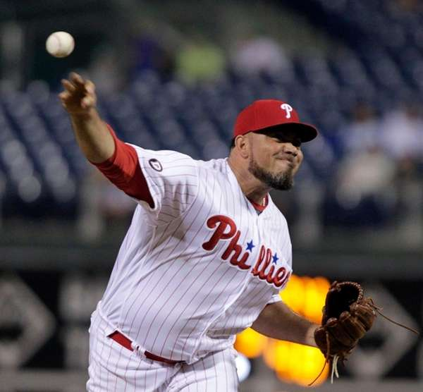 Philadelphia Phillies closing pitcher Joaquin Benoit, throws in