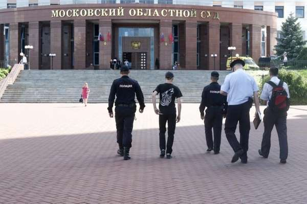 Police officers walk toward to the main entrance