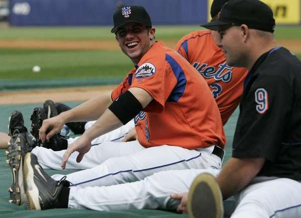 David Wright, left, jokes with Ty Wigginton while