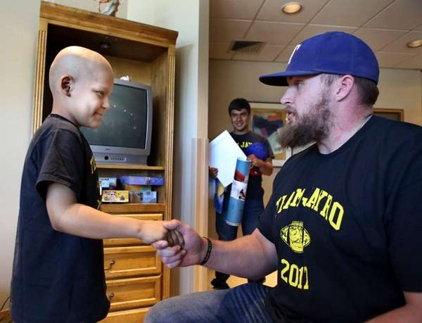 Cancer patient Jayro Ponce, 9, left, meets New