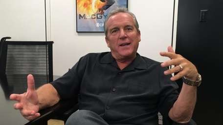 Brad Nessler gestures while speaking in New York,