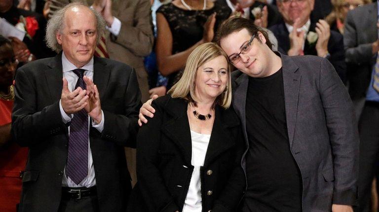 Max Barry hugs his mother, Nashville Mayor Megan