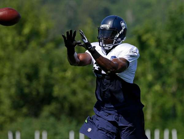 Seattle Seahawks strong safety Kam Chancellor catches the