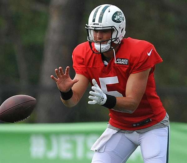 Christian Hackenbergtakes a snap duringJets training camp atthe