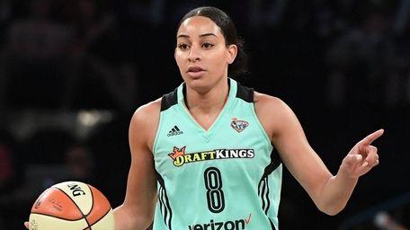 Liberty guard Bria Hartley calls a play against