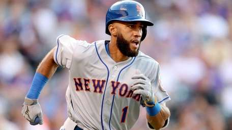Amed Rosario of the Mets flies out in