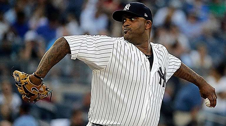 Yankees starting pitcher CC Sabathia delivers during the