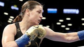 Katie Taylor corners Jasmine Clarkson during their lightweight