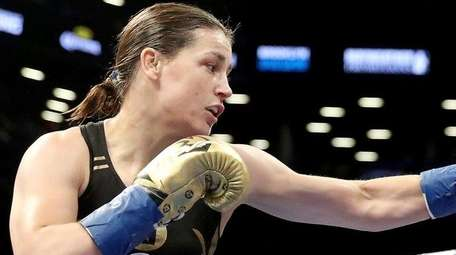Katie Taylor corners Jasmine Clarkson during their lightweight