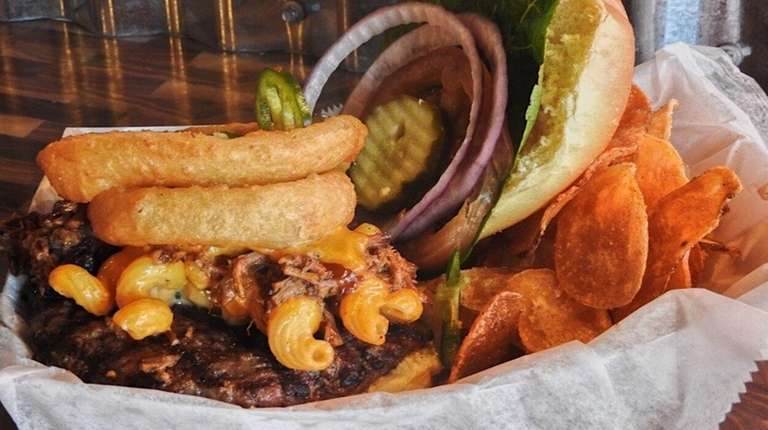 Barbecue brisket topped with macaroni and cheese, jalapenos,