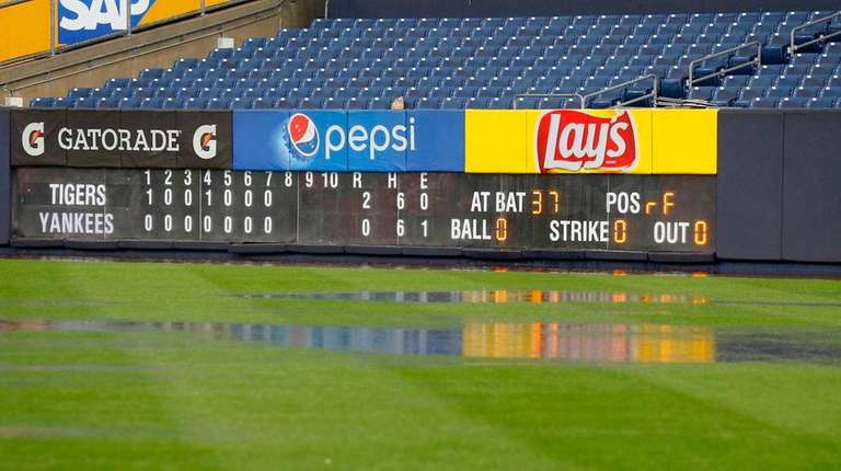 Water pools in the outfield during a rain