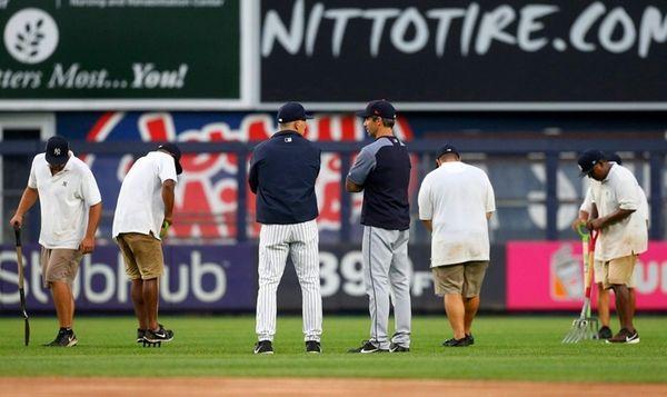 Managers Joe Girardi of the Yankees and Brad