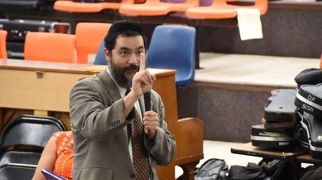 Hempstead schools Superintendent Shimon Waronker speaks during a