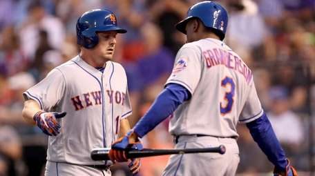 Jay Bruce of the Mets is congratulated by