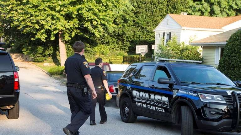 Police investigate the scene of a fatal shooting