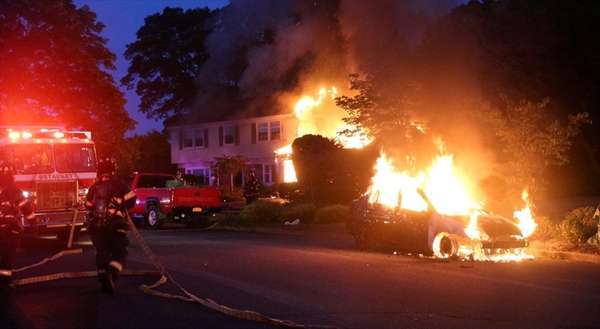 Firefighters respond to the scene of a fire