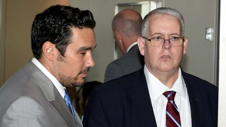 John Carney, right, former Islip Public Safety commissioner,