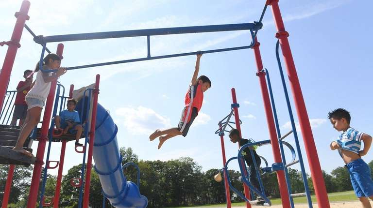 Children play at Roberto Clemente Park in Brentwood