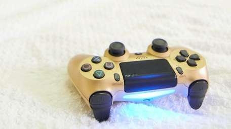 A controller for a video game sits on