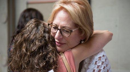 Paulette Mitacek, mother of Paul Mitacek, reacts after