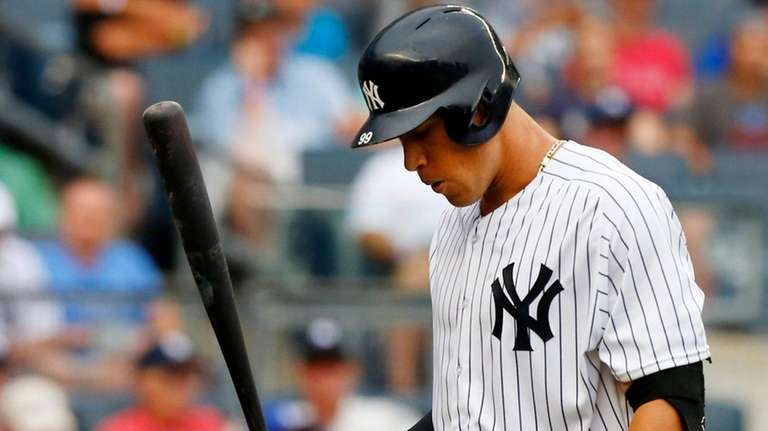 Aaron Judge of the Yankees walks back to