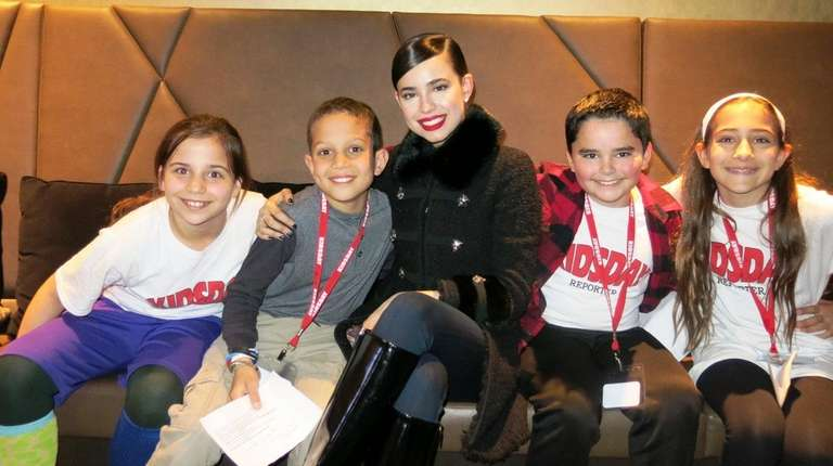 Actress Sofia Carson with Kidsday reporters, from left,