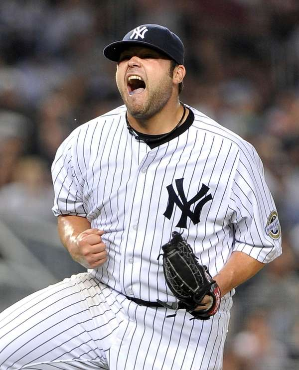 Joba Chamberlain celebrates in a 2009 file photo.