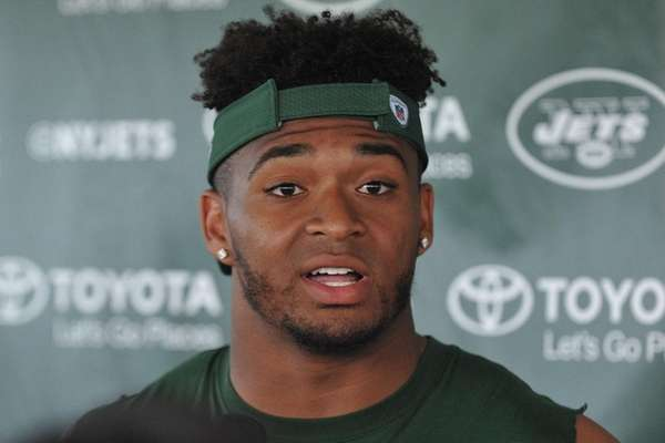Jamal Adams speaks with the media after a