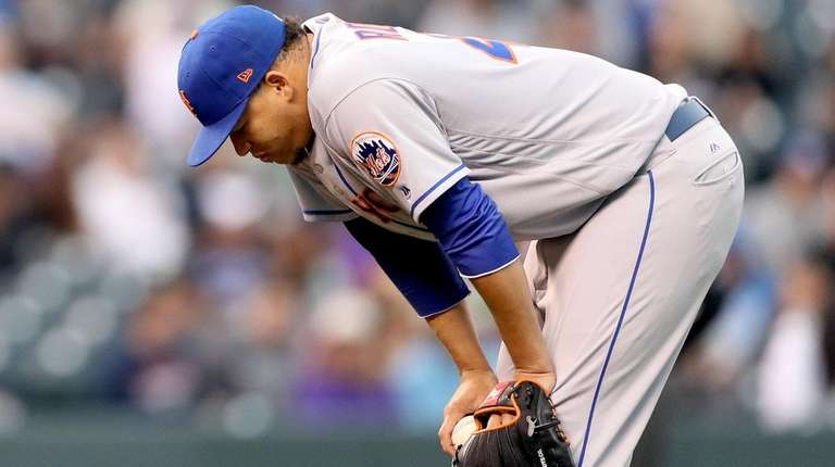 Hansel Robles of the Mets pauses after a