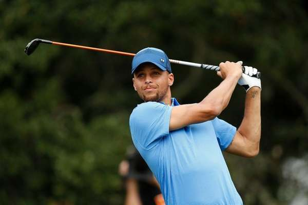 Stephen Curry plays his tee shot on the