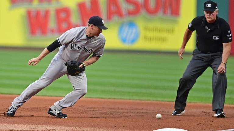 The Yankees' Chase Headley chases after a ball