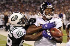 New York Jets cornerback Lito Sheppard breaks up