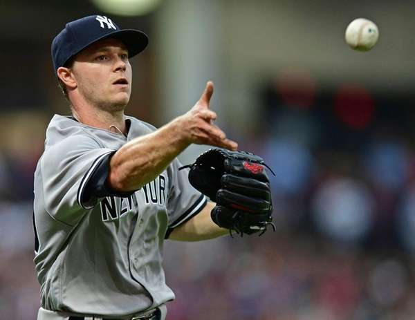 Yankees pitcher Sonny Gray tosses the ball to
