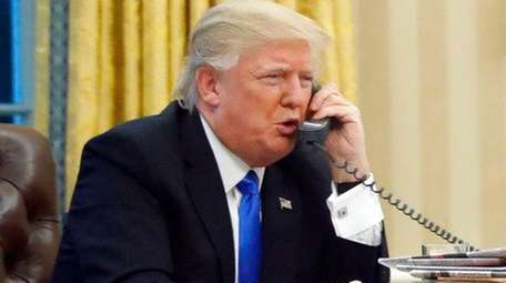 President Donald Trump speaks on the phone with