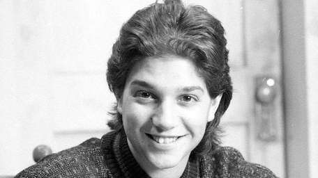 Ralph Macchio with an NHL bobblehead doll of