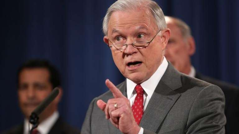 Attorney General Jeff Sessions, accompanied by, from left,