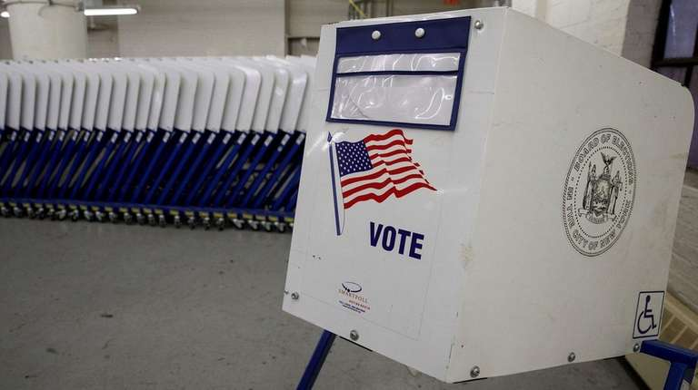 Voting booths sit at a New York City