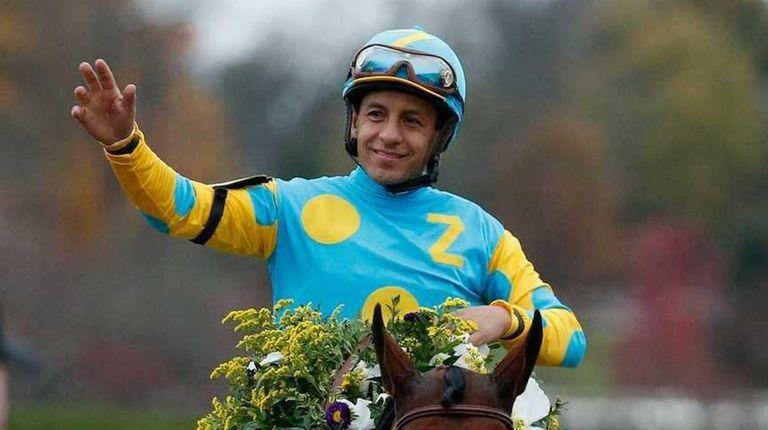 Jockey Victor Espinoza gets back to the winner's