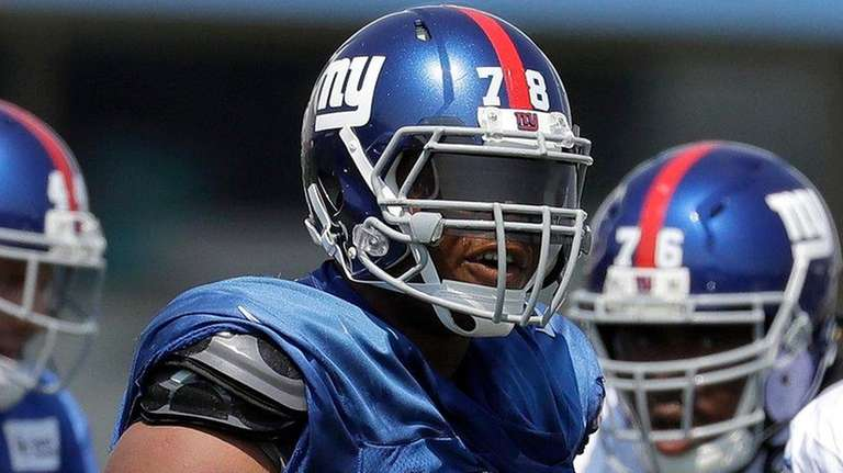 Giants defensive end Romeo Okwara, left, and offensive