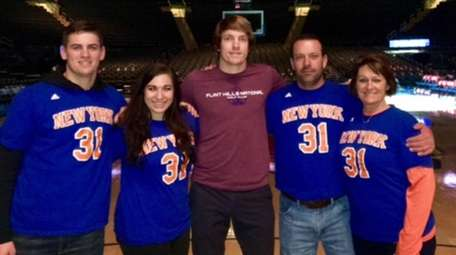 Knicks guard Ron Baker, center, with his family