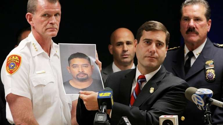 Suffolk County Police Commissioner Timothy D. Sini holds